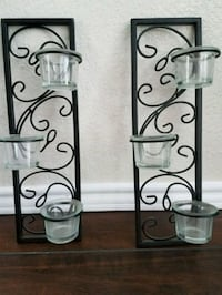 two black metal candle holders