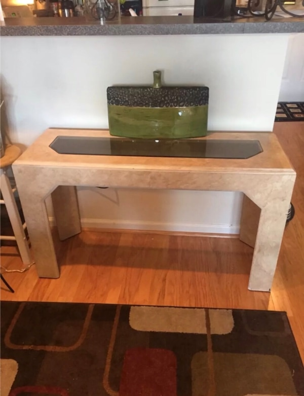 Creme framed glass top table