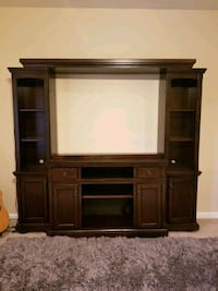 brown wooden TV hutch with flat screen television Alexandria