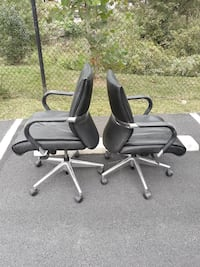 two black-and-gray rolling armchairs 32 km