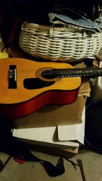 brown and black acoustic guitar North Pole, 99705