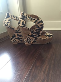 pair of black-and-brown wedge sandals Surrey, V3S