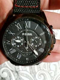 round black chronograph watch with black leather strap Winnipeg, R2L 0L5