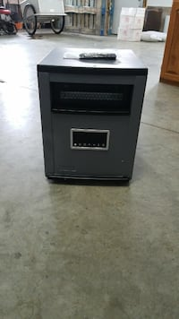 black and gray space heater with remote control