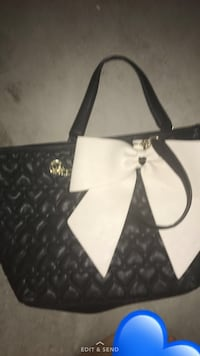 white and black leather bow accent tote bag