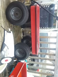 Jacked up red and black wagon London, 43140