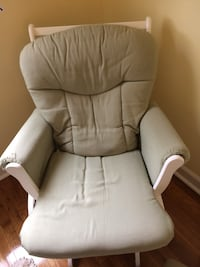 Green and white padded glider chair