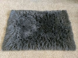 Faux fur area rug