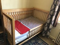 brown wooden crib with mattress Arlington, 22204