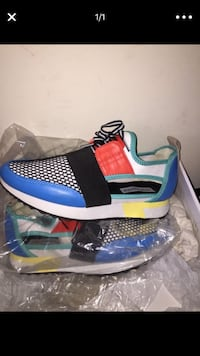 unpaired blue and white Nike basketball shoe Baltimore, 21229