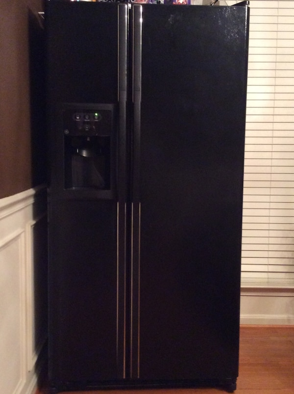 black side by side refrigerator with dispenser
