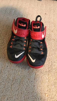 red-and-black Nike Lebron James basketball shoes
