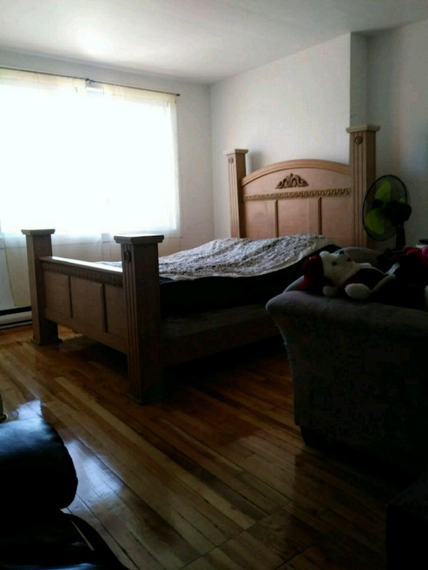 brown wooden 4-post bed