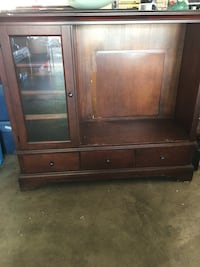 brown wooden TV hutch with flat screen television Ranson, 25438