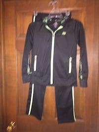 Girls size 10/12 New Balance warm up jacket/pants.  Color is black with lime green accents. Elizabethton, 37643