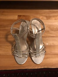 pair of silver-colored open-toe heels Laval, H7W 1T6