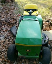 green and black ride on mower Ashland, 01721