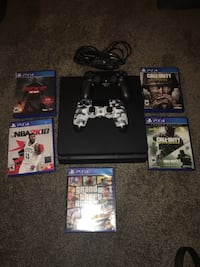 PlayStation 4 1TB slim 2 controllers 5 games Peoria, 61604