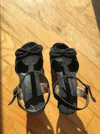 pair of black-and-brown sandals