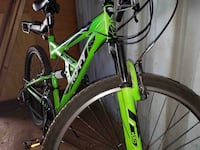 green and black hardtail mountain bike 2246 mi