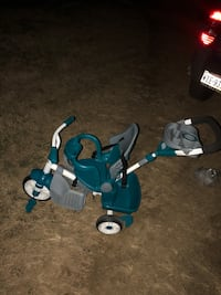 Baby's teal and gray push tricycle