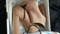 pair of brown leather heeled booties Surrey, V3S 3V8