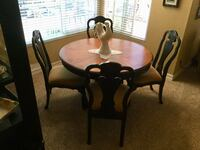 round brown wooden table with four chairs dining set Chula Vista, 91913
