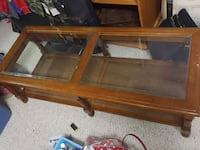 brown wooden framed glass top coffee table Edmonton, T5Y 2H2