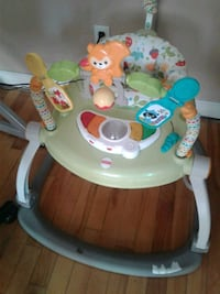 baby's green and white Fisher-Price walker 798 km