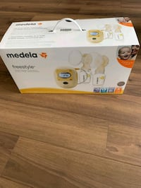 white Medela electric breast pump box Kitchener