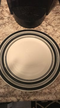 round white and black ceramic plate