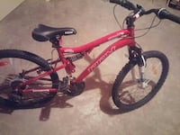 red CCM full-suspension mountain bike