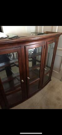 brown wooden framed glass display cabinet Anniston, 36206