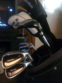 Golf clubs, driver, putter, and bag...