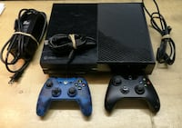 black Xbox One console with two controllers Westover