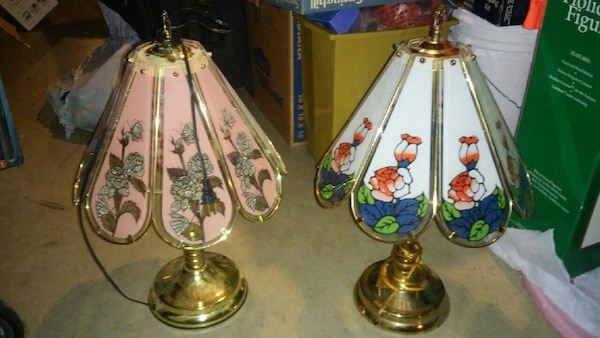 two clear glass table lamps