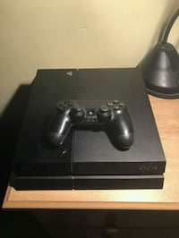 black Sony PS4 console with controller Brampton, L7A 3A2