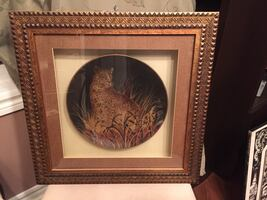Brown cheetah plate in a brown wooden frame