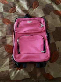 pink and black luggage bag Riverview