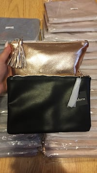 Rose gold or black leather purses/cosmetic bag