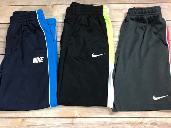 Used two black and blue Nike sweat pants for sale in Canton - letgo e713cbce2544