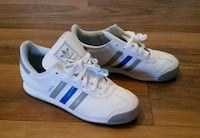 pair of white-and-blue Adidas Superstar Springfield