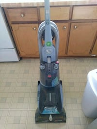 blue and gray Hoover upright vacuum cleaner