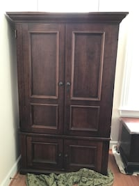 brown wooden 4-door cabinet