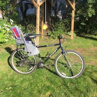 Black Giant trail bike with baby seat.