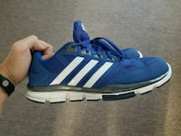 pair of blue-and-white Adidas sneakers
