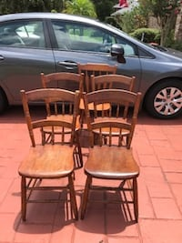two brown wooden windsor chairs Lutz