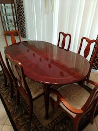 oval brown wooden dining table with chairs set Sarasota, 34241