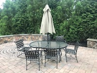 Patio table, chairs, umbrella and love seat-moving sale-must go Ashburn, 20147