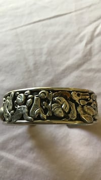 Beautiful silver and a little gold bracelet  Corrales, 87048